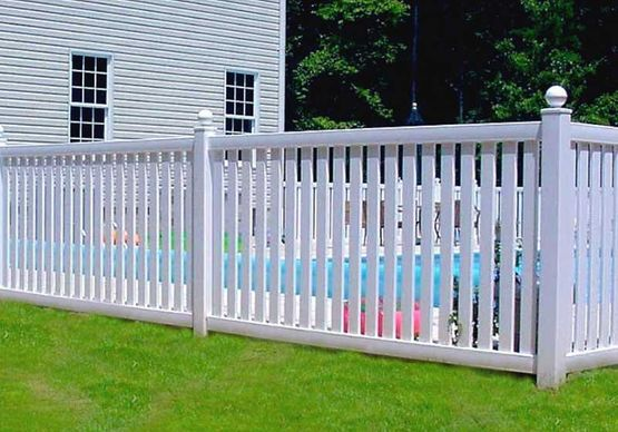 White fence around a swimming pool