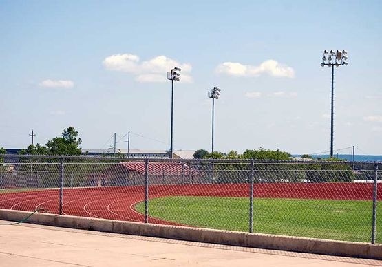 chainlink fence around running track