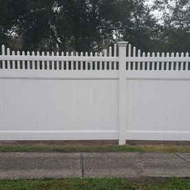 white fence on a street