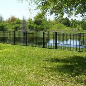 black fence by a lake