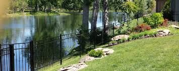 aluminum fence around pond