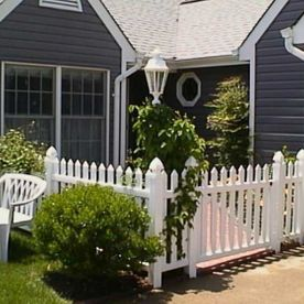 home with white fence